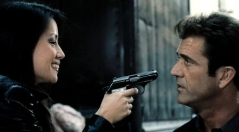 Lucy Alexis Liu und Mel Gibson in «Payback»